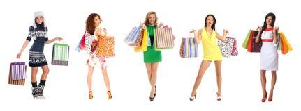 bags härliga unga shoppingkvinnor Fotografering för Bildbyråer