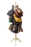 Bags hanging on coat rack Stock Photography