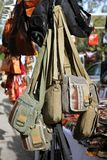 Bags hanging in market shop green khaki brown Stock Image