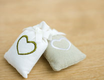 Bags with heart symbol Stock Photos
