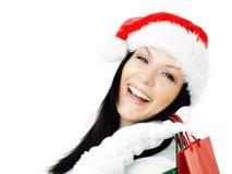 bags jul som rymmer över shoppingwhitekvinna Fotografering för Bildbyråer