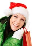 bags jul som rymmer den le kvinnan för shopping Royaltyfria Foton