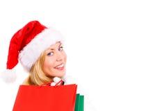 bags jul som rymmer shoppingkvinnan Royaltyfria Bilder