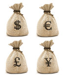 Bags with money. Sacks with money different currencies isolated with clipping path inckuded Royalty Free Stock Photo