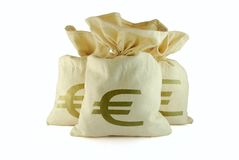 Bags of money. Three bags of money on the white background royalty free stock photo