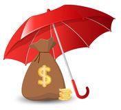 Bags of money and golden coins under an umbrella Stock Image