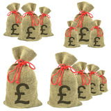 Bags of money with Pounds Sterling. Currency on a white background stock photos