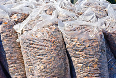 Bags with mulches used for garden decorating Stock Image