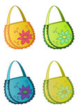 Bags multi-coloured. Four multi-coloured female handbags with a flower pattern royalty free illustration