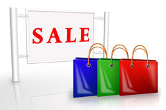 Bags near a placard sale Royalty Free Stock Image