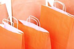 bags orange shopping för gåva Royaltyfria Bilder