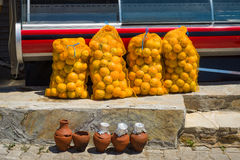 Bags of oranges. Stock Images