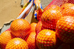 Bags of oranges Stock Photos