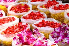 Bags of red and purple colored orchid petals and yellow marigold for Chinese ceremony Royalty Free Stock Photo