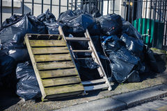 Bags of rubbish in the street Stock Photography