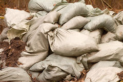 Bags with sand are piled a wall stock images