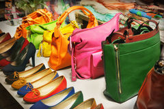 Bags and shoes. Shop window with bags and shoes Stock Photos
