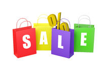 Bags Spelling SALE. Four colourful bags isolated in white background with letters spelling SALE and a percentage sign in one of them Royalty Free Stock Images