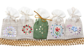Bags with spice and golden necklace Stock Photos