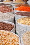 Bags of spices, saffron, cereals, pulses, corn, nuts in the salt market of the Old City of Sana'a, suq, Yemen, seller, daily life. The Old City of Sana'a, the Royalty Free Stock Images