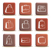 Bags and suitcases doodles on buttons Stock Images