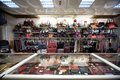 Bags, suitcases, purses and scarfs in shop. Of leather goods and accessories Stock Photos