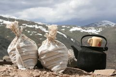 Bags with test of the mountain sorts and teapot Royalty Free Stock Photo