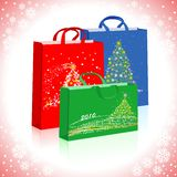 Bags to gifts. Three different bags with New Year's pictures Stock Image
