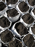 Bags of topsoil. Stacked in rows ready for landscaping Stock Photography