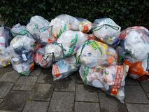 Bags with waste of plasic and metal, seperated by residents, to be collected by the municipality of Zuidplas. Bags with waste of plasic and metal, seperated by royalty free stock photography