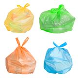Bags with waste sorted for recycling. Plastic bags in various colors with waste such as plastic, paper, metal and glass sorted for recycling royalty free stock images