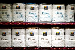 Bags of white flour from Whole Foods Market Stock Photography