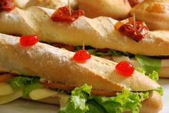 Baguette. Long whole wheat baguette sandwich with lettuce stock image