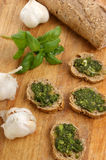 Baguette as a snack with fresh pesto Stock Images