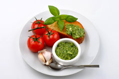 Baguette as a snack with fresh pesto Stock Photos