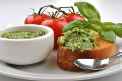 Baguette as a snack with fresh pesto Stock Photo