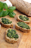 Baguette as snack with homemade fresh pesto Stock Images