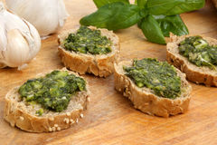 Baguette as snack with homemade fresh pesto Stock Photo