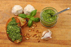 Baguette as snack with homemade fresh pesto Stock Image