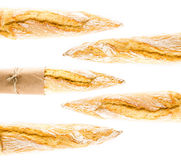 Γαλλικό φλοιώδες Baguette ολόκληρου του ψωμιού σίτου σε ένα άσπρο backgrou Στοκ Φωτογραφία