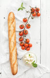 Baguette with banch of cherry-tomatoes, basil and Royalty Free Stock Images