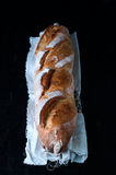 Baguette on black background. royalty free stock images