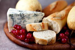 Baguette with blue cheese and fruits. Close up of baguette,blue cheese and fruits Royalty Free Stock Images