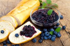 Baguette with blueberry jam Royalty Free Stock Image