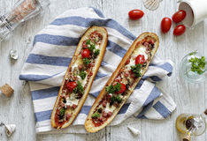 Baguette boats with chicken and mushrooms stock image