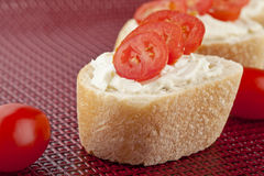 Baguette bread with butter and tomato slices Stock Photos
