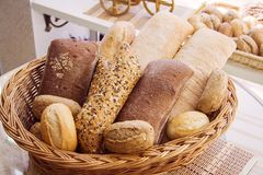 Baguette bread in lovely basket. Closeup of some long French baguette bread Stock Images