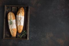 Baguette bread with rosemary royalty free stock photo