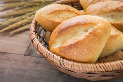Baguette or bread in wicker basket Stock Images