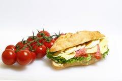 Baguette bun, salami, cheese, lettuce and boiled eggs Stock Photos